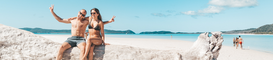 Couple having fun on Whitehaven beach, Powerplay