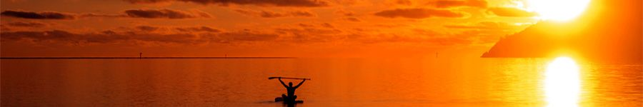 Sunset paddleboarding Whitsunday Blue