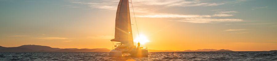 On Ice sunset sailing Whitsunday Islands luxury catamaran private charter