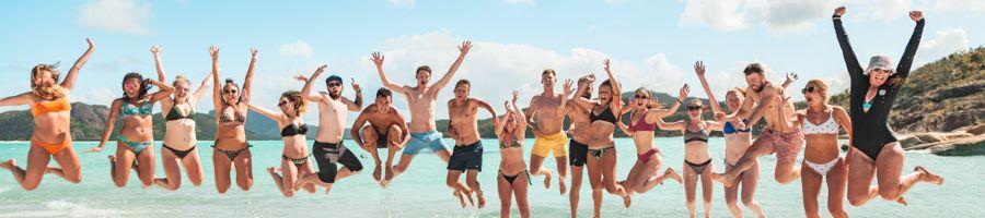 Whitehaven Beach Boomerang crew jumping
