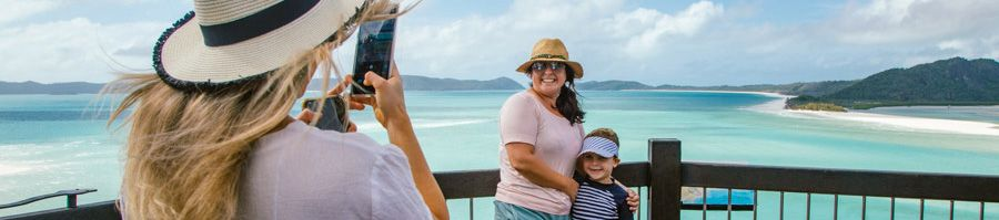Girl Taking picture to a family at Hill Inlet Lookout