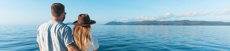 Powerplay deck couple Whitsunday Islands luxury catamaran